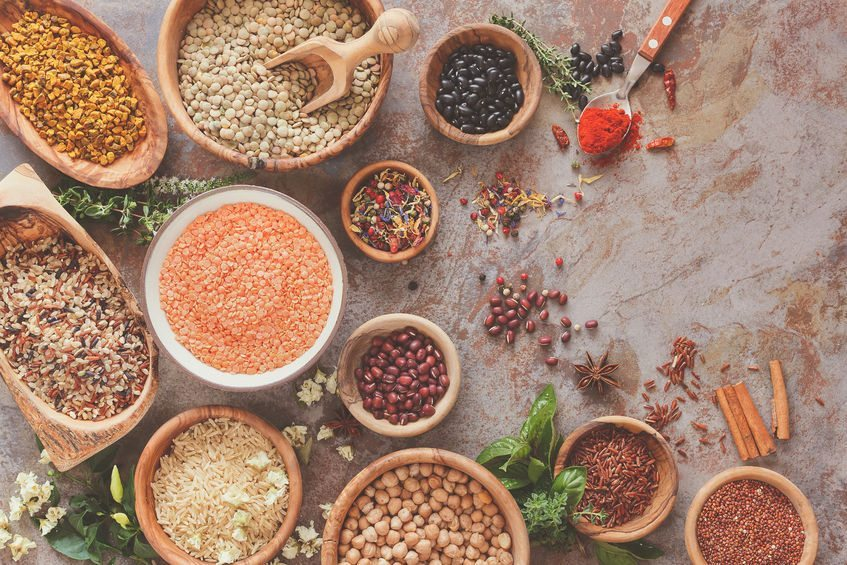 44165615 - assortment of legumes, grain and seeds. various types of grains, rice, legumes spices and herbs in bowls on rustic table, top view